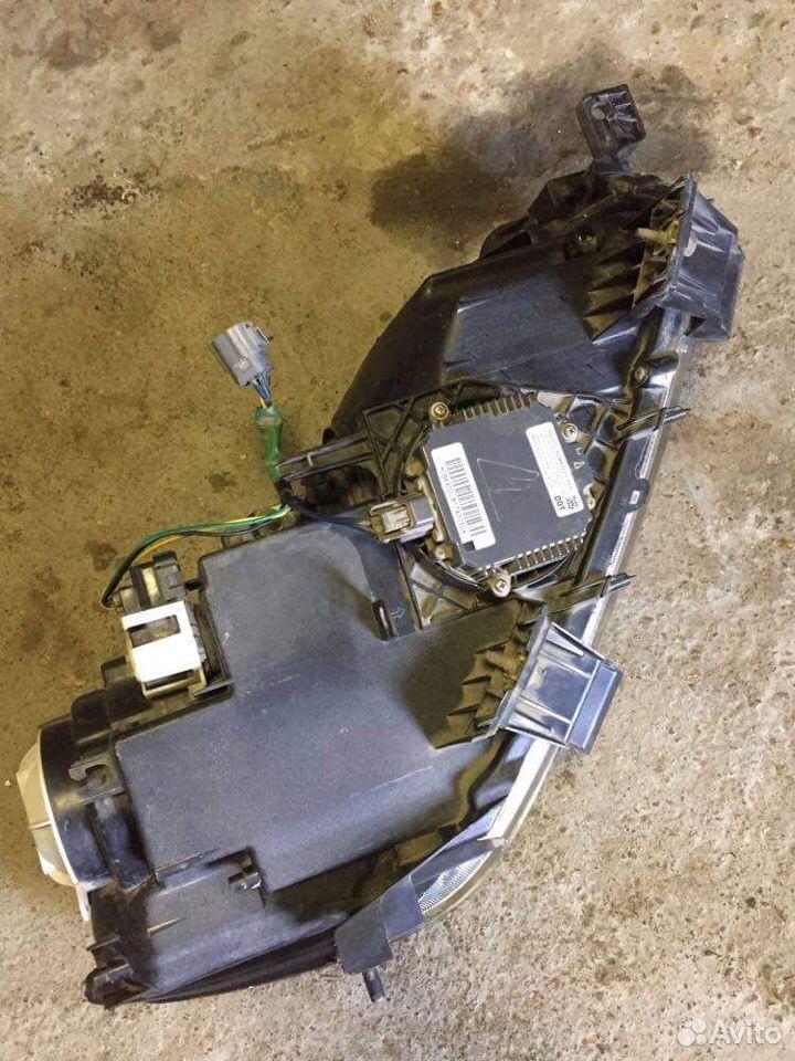 Левая фара ксенон Mazda CX-7 2006) EH1051040